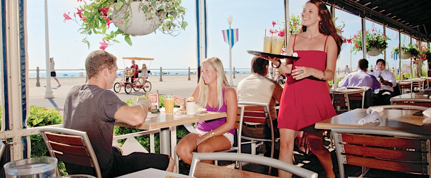 Couple eating by the beach at restaurant