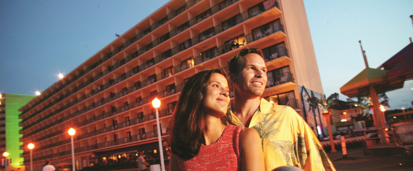 Couple Standing in Front Of The Hotel
