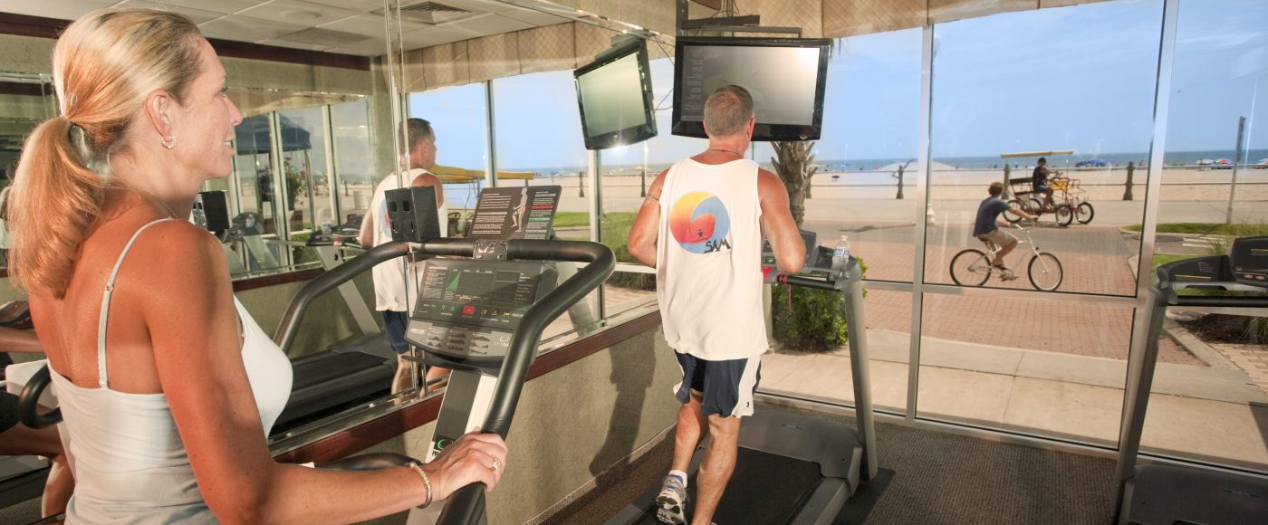 Couple Working Out At Gym with Beach View